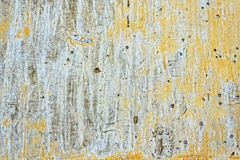 Grunge texture of old wall. Cracked stucco crumbles. Royalty Free Stock Photo