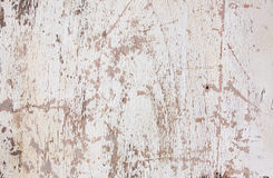 Grunge texture,white paint peeling from wooden surface Royalty Free Stock Photos