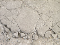 Grunge textured concrete sidewalk with cracks Stock Image