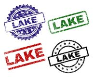 Grunge Textured LAKE Seal Stamps. LAKE seal stamps with damaged style. Black, green,red,blue vector rubber prints of LAKE title with grunge style. Rubber seals royalty free illustration