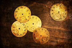 Grunge textured picture of antique clock faces Stock Images