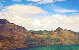 Grunge textured rugged Mountain range stock photos