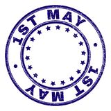 Grunge Textured 1ST MAY Round Stamp Seal. 1ST MAY stamp seal imprint with grunge effect. Designed with circles and stars. Blue vector rubber print of 1ST MAY stock illustration