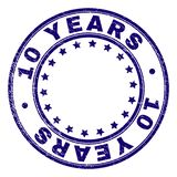Grunge Textured 10 YEARS Round Stamp Seal. 10 YEARS stamp seal imprint with distress texture. Designed with round shapes and stars. Blue vector rubber print of royalty free illustration