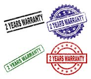Grunge Textured 2 YEARS WARRANTY Stamp Seals. 2 YEARS WARRANTY seal prints with distress surface. Black, green,red,blue vector rubber prints of 2 YEARS WARRANTY Vector Illustration