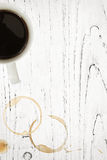 Grunge Timber with Coffee Cup and Stains. Coffee mug with stains and splashes overgrunge white timber background Royalty Free Stock Photos