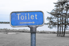 Grunge toilet sign in blue color Royalty Free Stock Photos