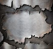 Grunge torn metal plate as steam punk background Stock Photos