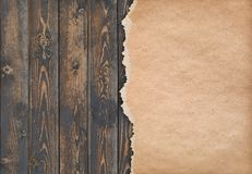 Dark wood background with torn old paper stock image