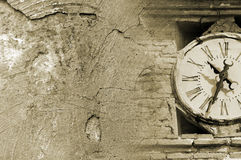 Grunge tower clock. Tower clock detail over grunge background Royalty Free Stock Photo