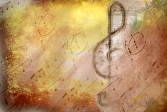 Grunge treble clef musical poster Stock Photos