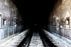 Grunge tunnel entrance. Railroad tunnel entrance - processed for grunge look, blown highlights Stock Photography