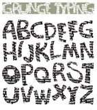 Grunge typing font Royalty Free Stock Photos