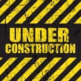 Grunge under construction background Stock Photos