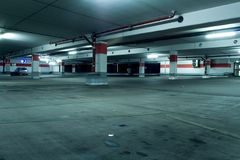 Grunge underground parking garage with car Royalty Free Stock Photos