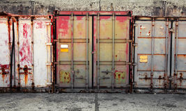Grunge urban interior with old cargo containers Stock Photography