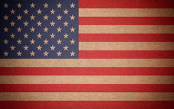 Grunge USA flag background on recycled paper texture. Photo of grunge USA flag background on recycled paper texture Stock Images