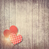 Grunge valentine background with two hearts Stock Photos