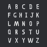 Grunge vector alphabet. On black background Stock Photography