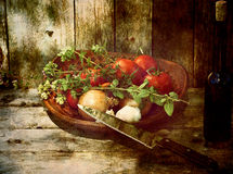 Grunge vegetables and wine on wood. Royalty Free Stock Image