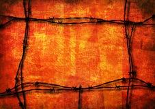 Grunge vermelho com arame farpado Fotos de Stock