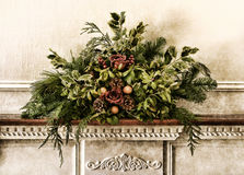 Grunge Victorian Christmas Old Floral Arrangement. Grunge vintage Victorian Christmas floral arrangement decoration with roses within pine branches and cones Stock Photo