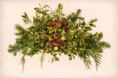 Grunge Victorian Christmas Old Floral Arrangement. Grunge vintage Victorian Christmas floral arrangement decoration with roses within pine branches and cones Stock Image