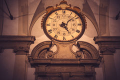 Grunge vintage clock on antique building Stock Photography
