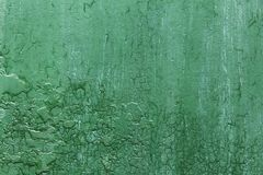 Grunge, Vintage. Closeup of an old green painted sheet iron, metal door with peeling paint and rust. Royalty Free Stock Photo