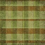 Grunge vintage distressed dark green and brown vertical and horizontal stripes tartan, plaid stock photography
