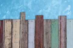 Grunge vintage fence on blue cement wall Stock Photography