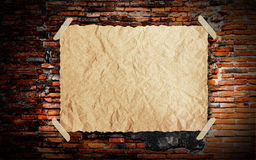 Grunge vintage old Brown paper on brickwall. Background Royalty Free Stock Photo