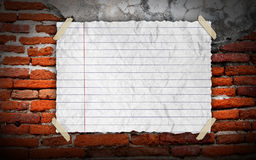 Grunge vintage old Brown paper on brickwall. Background Stock Photography