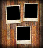 Grunge vintage photo frames on a wood Stock Photos