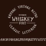 Grunge vintage whiskey font. Old handcrafted display skript. Modern brush label lettering. Vector typography Royalty Free Stock Images