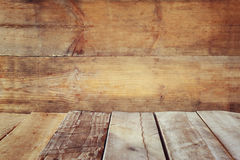 Grunge vintage wooden board table in front of old wooden background. Ready for product display montages Stock Photos