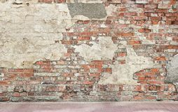 Grunge wall background. Bricks and pieces of plaster royalty free stock photography