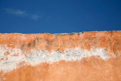 Grunge wall and blue sky Stock Image