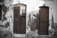 Grunge wall and doors in Mediterranean town. Grunge wall and doors in Mediterranean old town street Royalty Free Stock Photos
