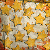 Grunge wall with drawn glowing stars Stock Photos
