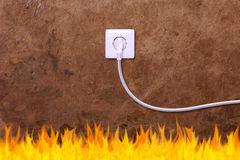 Grunge wall with an electrical outlet and fire Stock Photos