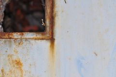 Grunge wall with metallic wicket detail with copy space. Royalty Free Stock Photos