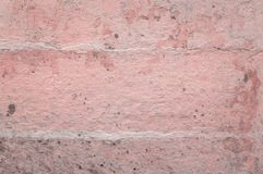 Old plaster hue rose quartz. Grunge wall of the old house. Textured background. Plaster hue Rose Quartz Royalty Free Stock Photography