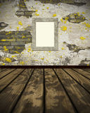 Grunge wall and parquet floor with empty frame. Royalty Free Stock Photos