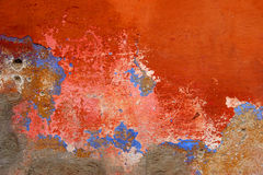 Grunge wall with peeling red paint. In Guatemala royalty free stock image
