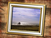 Grunge wall with picture. Picture with family walking by the seaside over grunge background royalty free stock photo
