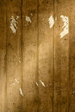 Grunge wall with torn poster. Stone texture on wall with remains of poster Stock Photos