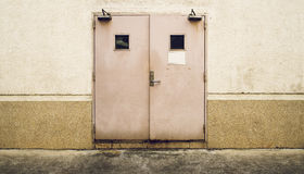 Grunge wall with twin door and dirty floor Royalty Free Stock Images