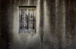 Grunge wall with window. Old wall with no glass and latticed window Stock Photography