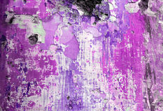 Grunge Wall With Peeling Purple Paint Royalty Free Stock Images